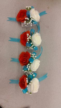 Created by Lauren Balajadia  Custom corsage for a turquoise and tangerine wedding  September 2015