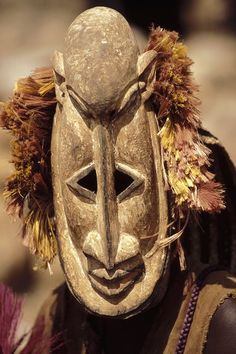 Africa | Masquerader wearing a Fulani herdsman mask (traditionally the enemy of the Dogon's).   Dogon country, Mali | ©Michel Renaudeau
