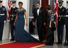 Michelle Obama in Marchesa  The president is stepping on her train!  (Cute First Couple)