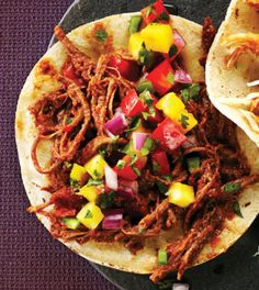Spicy Shredded Beef Tacos with Pineapple Salsa - could be good served on the cheesy masa cakes