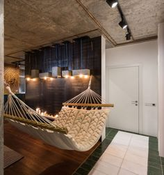 Searching for some unique and modern wall décor for your apartment living room? I love the idea of a hammock in the living room! And don't miss the cement light fixtures!