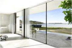 Stunning Interior With Glass Wall And Natural Scenery With Adorable House In Modern Decoration Style Engaging Ocean View