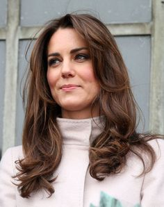 Love her long layers!  Nice cut for thick hair (now, how to get warm chocolate brown hair color without looking like a doofus?)