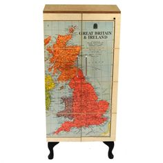 Birch plywood cupboard featuring a beautiful vintage UK Map.The 1955 linen backed school map of UK and Ireland is lacquered and matt varnished, mounted onto an oiled birch ply construction incorporating two shelves. The cupboard stands on beautiful, blackened Queen Anne legs.