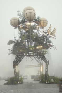 Aeroflorale II - La Machine by frashier on Flickr.  For the 2010 Bauhaus Color Festival in Dessau, Germany, the French art group La Machine installed this towering kinetic sculpture, complete with hanging vegetation, propellers, fins, and balloons. Dubbed the Aeroflorale II,
