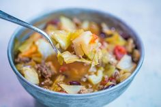 Hearty and extremely delicious, this one pot hamburger cabbage soup is easy to make and always a huge hit! Simple ingredients for a family favorite soup everyone loves! This cabbage soup has tons of meaty flavor, Hamburger And Cabbage Recipe, Hamburger Macaroni Soup, Hamburger And Potatoes, Hamburger Stew, Cabbage Potato Soup, Cabbage And Potatoes, Cabbage Soup Recipes, Easy Cabbage Rolls, Cabbage Rolls Recipe