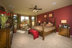 Gehan Homes - Master Bedroom  San Antonio, Texas | Gordons Grove - Stanford  Old world, wrought iron, red tulips, red pop, crimson accent walls, satin drapes, romantic reds  #Gehanhomes