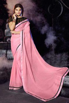rose sari en mousseline de soie avec chemisier en soie d'art Prix:-61,81 € nouvelle collection de saris concepteur d'arrivée sont maintenant en magasin présenté par Andaaz la mode comme le rose sari en mousseline de soie avec chemisier en soie d'art. embelli avec de la pierre, concepteur Pallu, bateau chemisier col, manches courtes, chemisier. cette robe est préfet pour la fête, mariage, fête, cérémonie http://www.andaazfashion.fr/pink-chiffon-saree-with-art-silk-blouse-dmv7786.html