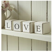 Wooden Blocks-Love  Set of wooden building blocks spelling out the word love. A trendy shelf sitter. Each block 5cm square. From the site http://www.livelaughlove.co.uk/Wooden-Blocks-Love.html
