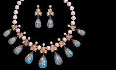 Mesmerizing inlaid turquoise drops gracefully strung with south sea pearls and uncut diamonds.