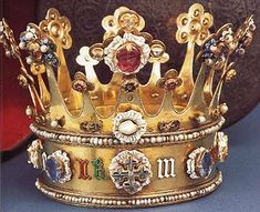 Crown of Margaret of York (1446-1503) Made to fit over a henin (conical headdress) and worn to her wedding to Charles of Burgundy in July, 1468.  Margaret's crown of silver-gilt, enamel, precious stones and pearls is one of only two English crowns from the medieval regalia to have survived Cromwell's ravages