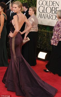 Taylor Swift IN DKNY at the Golden Globe Awards in LA on Sunday dark red gown