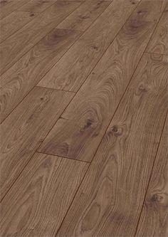 12mm Atlas Oak: This coffee-coloured laminate flooring is perfect for elegant interiors of all stripes.