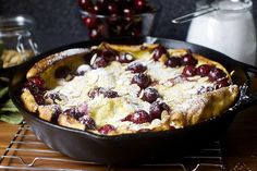Deb does it again. Cherry Almond Dutch Baby from Smitten Kitchen Amish Recipes, Dutch Recipes, Cooking Recipes, Yummy Recipes, Delicious Desserts, Yummy Food, Dutch Pancakes, Dutch Baby Pancake, Oven Pancakes