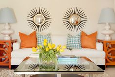 Decorating and Design Tips from Tobi Fairley - Traditional Home®- love the double sunburst mirrors and the side tables