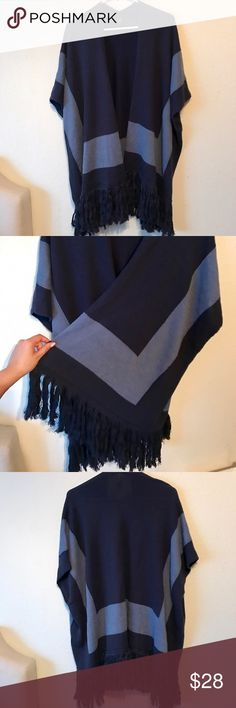 NWOT Echo Navy Blue Fringe Trim Wrap/Poncho NWOT Super cute wrap/poncho. Has navy blue and light blue on the wrap. This are super in right now & super warm! 87% Cotton 13% Ramie. Make me an offer 💕 Echo Sweaters Shrugs & Ponchos