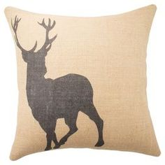 Offering mountain lodge inspiration for your sofa or favorite reading nook, this burlap pillow showcases a striking deer in silhouette.  Product: PillowConstruction Material: Burlap coverColor: NaturalFeatures:  Handmade by TheWatsonShopInsert includedMade in the USA Zipper enclosureCleaning and Care: Spot clean