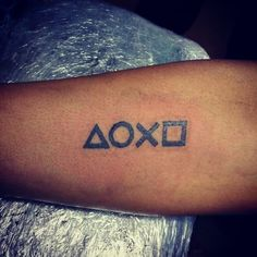 Playstation Button tattoo on my for arm.