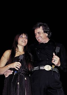 Johnny Cash with daughter Rosanne Cash performing on stage