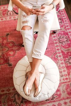 An adorable pouf and chic area rug from Lulu
