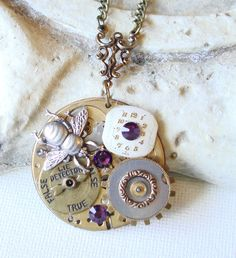 Steampunk Vintage Pocket Watch Movement Plate - Bee and Swarovski Crystal Necklace   C 1-9 by BlackStoneFoundry on Etsy https://www.etsy.com/listing/199887772/steampunk-vintage-pocket-watch-movement