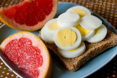 Whole wheat toast with 2 hard boiled eggs and a half of a grapefruit