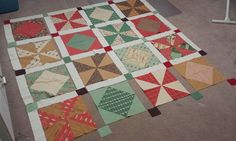 04/28/14- http://www.tidelinequilts.com/Blog.html?entry=cozy-cottage-pinwheels My new quilt continues to make progress, although not as quickly as I might have hoped.  I have four out of five rows of blocks completed, with one more to go...and I'm still happy with how it's coming along. With a good push tonight, I should be able to finish the blocks and begin assembling the rows.