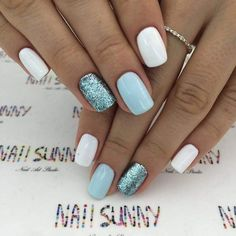 White pastel blue and glitter nails. Modern chic nails. Chic short nails.