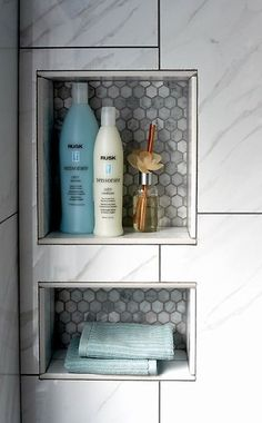 Love the tile detailing of this shower cubby- Large rectangle & hexagon white carerra marble.