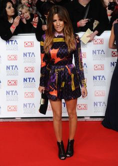 Caroline Flack Print Dress - Caroline Flack went the funky route at the National Television Awards in this collared silk dress. Caroline Flack Style, Long Graduated Bob, Celebrity Photos, Celebrity Style, Sexy Legs And Heels, Tv Presenters, Beautiful People, Peplum Dress, Glamour