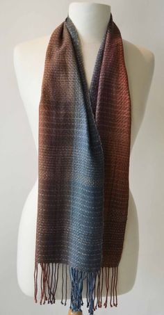 """This pretty scarf measures 9"""" x 68"""" This scarf was handwoven using 100% silk yarn. Care instructions: hand wash, hang to dry, steam press..."""