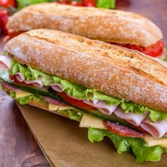 Two Long Ciabatta Sandwiches with lettuce, slices of fresh tomatoes, cucumber, ham, salami and cheese - stock photo Sandwich Sous-marin, Baguette Sandwich, Submarine Sandwich, Pan Baguette Receta, Healthy Sandwiches, Tasty, Yummy Food, Healthy Food, Meat And Cheese