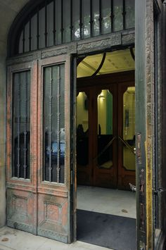 https://flic.kr/p/rrgJfr   Former Ernst Museum   Copper door.  The building was built in 1912 for Ernst Lajos, the remarkable art collector, to introduce his rich  collection.  Design: Fodor Gyula, late Art Nouveau style Stained glass windows: designed by Rippl Rónai József, Falus Elek, made by Róth Miksa  Black marble seats (in the hall) and the staircase: design by Lechner Ödön.  --------------- Lajos Ernst, a  private collector and a well-known figure of Budapest society, founded the…