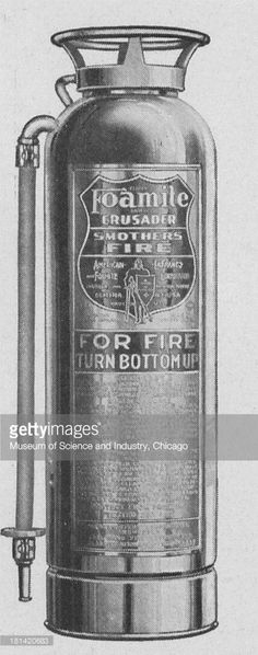 Black and white image of a two and a half gallon Foamite Crusader fire extinguisher of the foam type, late 1920s or early 1930s. It orginally appeared in 'Crusading Against Fire,' published by American-La France And Foamite Industries Incorporated.
