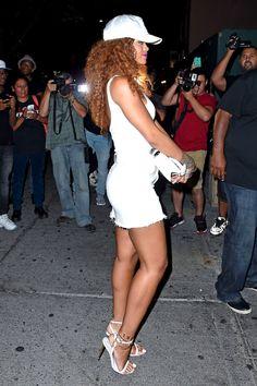 5 Rihanna's Griffin H&M White Racerfront Bodysuit, Mother Denim Skirt, V Files White Cap, and Tom Ford Naked Padlock Sandals