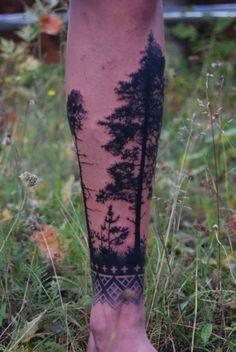 Creative pine tree arm tattoo
