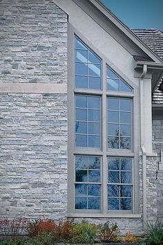 This gorgeous home features Chilton Country Squire stone veneer, Wall Stone, & Snapped Steps. Stone Masonry, Stone Veneer, Brick And Stone, Patio Stone, Exterior Gray Paint, Exterior House Colors, Black Window Trims, Marble House, Building Stone