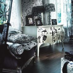 Okay, my style is gothic-meets-shabby-chic, for sure.  Adore that bureau.