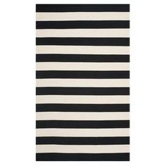 """Add a timeless touch to your living room seating group or master suite decor with this hand-woven cotton rug, showcasing classic striping in black and white.   Product: RugConstruction Material: CottonColor: Black and whiteFeatures:  Hand-wovenMade in IndiaFlatweave Pile Height: 0.25"""" Note: Please be aware that actual colors may vary from those shown on your screen. Accent rugs may also not show the entire pattern that the corresponding area rugs have.Cleaning and Care: Professional ..."""