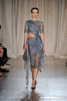 Marchesa....probably a month and half of my take home pay (which I'd never spend)...but it's gorgeous!