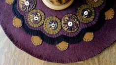Layered Wool Penny Rug Candle Mat with Yo yos and Vintage Buttons in Soft Mauve and Brown Earth Tones