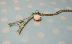 """Antique bronze teal patina Eiffel Tower necklace w/ creamy cabochon rose and teal faceted glass bead 