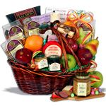 Bountiful Harvest™ - Fruit Gift Basket  Gourmet GB.com  $107.99  a wonderful selection of orchard fresh apples, succulent pears and juicy naval oranges.  smoked salmon, sharp Vermont cheddar cheese, crackers, summer sausage and champagne mustard, chocolate cherries, two incredible jams, fresh roasted mixed nuts, harvest granola, mixed dried fruits, banana chips, and Holland mints. For dessert or fruit dipping, you'll also find a delectable caramel dip and incredible chocolate chip cookies!