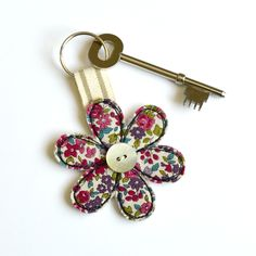 Pretty handmade fabric flower key-ring sewn using freehand machine embroidery by Stitch Galore