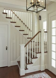 A classic entryway w/ very limited space; millwork & lighting (from windows & fixtures) adds beauty, interest & light -- Shingled River Retirement Cottage stairs Shingled River Cottage Cottage Staircase, Small Staircase, Staircase Railings, House Stairs, Staircase Design, Entryway Stairs, Staircase Ideas, Craftsman Staircase, Space Saving Staircase