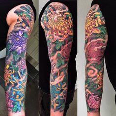 Chrysanthemums tattoo sleeve.
