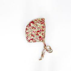 """Our Classic Bonnet in Liberty Floral is fully lined and made of 100% woven cotton in a lovely Liberty of London floral print.Size Guide:0-3 months fits up to 16""""3-6 months fits up to 17""""6-12 months fits up to 18""""12-24 months fits up to 19.5""""Care Instructions: Machine Wash with like colors. Tumble Dry Low. Iron Low heat."""