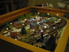 Model train layout in a coffee table. Yes Please.