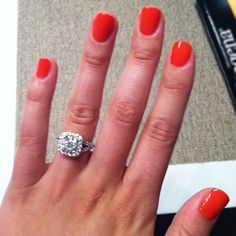 Mallory's split-shank cushion halo Ritani  engagement ring. Love the red nails too!
