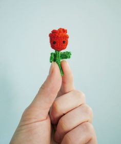Knit a tiny rose for your sweetheart.  Check out the pattern on @mochimochiland